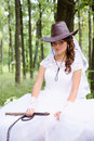 Bride with a whip beautiful in cowboy hat and Stock Image