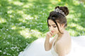 Bride in white dress with bouquet. Wedding, outdoor Royalty Free Stock Photo