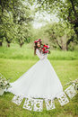 Bride in white dress in a garden Royalty Free Stock Photo