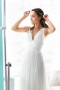 Bride in a white dress in a romantic scenery Royalty Free Stock Image