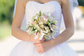 Bride with white wedding bouquet closeup of s hands holding orchid Stock Photo