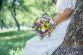 Bride in white wedding dress holding wedding bouquet. Royalty Free Stock Photo