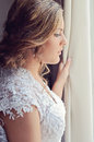 Bride at window a beautiful standing looking out Royalty Free Stock Photography