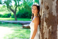 Bride woman happy posing in outdoor tree Royalty Free Stock Image