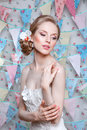 Bride.Young fashion model with perfect skin and make up, flowers in hair. Beautiful woman with makeup and hairstyle in bedroom. Royalty Free Stock Photo