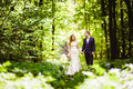 Bridegroom and bride in the spring forest Royalty Free Stock Photo