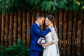 Bridegroom embraces the bride. Wedding couple in love at wedding day