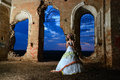 Brideis pray in the old ruined church bride at night room of destroyed Stock Images