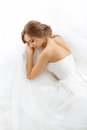 Brides beauty. Young woman in wedding dress indoors Royalty Free Stock Photo