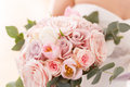Brides bouquet of roses, tulips and eucalyptus Royalty Free Stock Photo