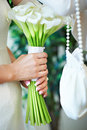 Brides hands with bouquet Royalty Free Stock Photography