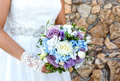 Brides hands holding bridal bouquet close up Royalty Free Stock Photo