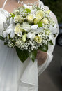 Brides holding beautiful bouquet of rose Royalty Free Stock Photo
