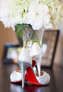 Brides red sole high heels wedding photo of a bride s heel shoes with soles Royalty Free Stock Images
