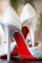 Brides red sole high heels wedding photo of a bride s heel shoes with soles Royalty Free Stock Photos