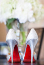 Brides red sole high heels wedding photo of a bride s heel shoes with soles Royalty Free Stock Photo