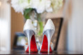 Brides red sole high heels wedding photo of a bride s heel shoes with soles Stock Photos