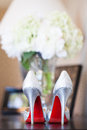 Brides red sole high heels wedding photo of a bride s heel shoes with soles Stock Images