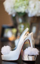 Brides red sole high heels wedding photo of a bride s heel shoes with soles Royalty Free Stock Photography