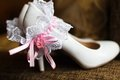 Brides shoes and garter Royalty Free Stock Photography