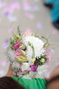 Bridesmaid with bouquet holding beautiful wedding Royalty Free Stock Photos