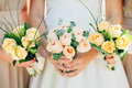 Bridesmaid dresses are holding bouquets in a rustic style Royalty Free Stock Photo