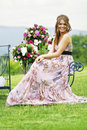 Bridesmaid and flower bouquets in nature Royalty Free Stock Photo