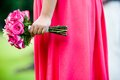 Bridesmaid holding a bouquet of flowers Royalty Free Stock Photo
