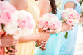 Bridesmaid holding a bouquet of roses at the wedding. Royalty Free Stock Photo