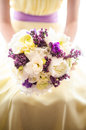 Bridesmaid holding the bride bouquet Royalty Free Stock Photo
