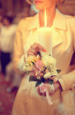 Bridesmaid holding candle with flowers Royalty Free Stock Photo