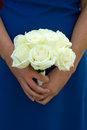 Bridesmaid holding white rose wedding bouquet Royalty Free Stock Photo
