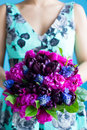 Bridesmaid holds a wedding bouquet of tulips and pions in purple tones Royalty Free Stock Images