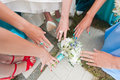 Bridesmaid struggle for the bouquet bride Royalty Free Stock Photography