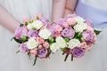 Bridesmaids flowers closeup two bouquet of are pink and purple roses Stock Photos