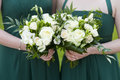 Bridesmaids hold flowers Royalty Free Stock Photos