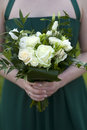 Bridesmaids hold flowers Royalty Free Stock Image