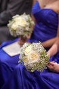 Bridesmaids holding wedding bouquets of white roses Royalty Free Stock Images