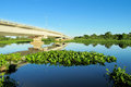 Bridge across blue water river Royalty Free Stock Photo