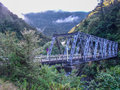 Bridge across glacial river crossing a deep in the heart of the southern part of new zealand Royalty Free Stock Image