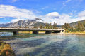 The bridge across mountain river Banff Stock Photos
