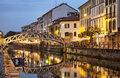 Bridge across the naviglio grande canal at evening in milan italy Royalty Free Stock Image