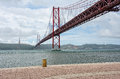 Bridge april lisbon portugal on a cloudy day Royalty Free Stock Photo