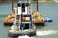 Bridge barge a small tugboat moves a during the construciton of the new sellwood in porland oregon Stock Images