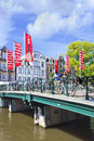 Bridge with bicycles and flags in Amsterdam Royalty Free Stock Photography