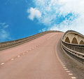 Bridge on blue sky with asphalt road Royalty Free Stock Image
