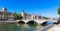 Bridge of change x pont au change x over river seine and concierge conciergerie castle castle conciergerie is a former prison Royalty Free Stock Images