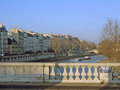 Bridge and flatboat paris france january scenery with on the river seine the left bank rive gauche looking west on a sunny winter Royalty Free Stock Photo