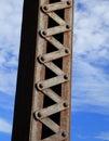 Bridge girder and rivets set against a blue sky Stock Image