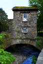 Bridge house over stock ghyll uk stone and slate landmark building on an arched in united kingdom is a national heritage site Royalty Free Stock Photography